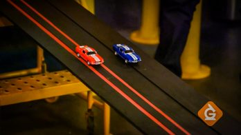 toy cars race to demonstrate friction