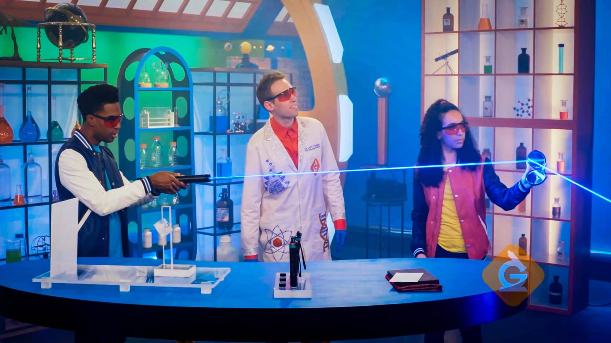 scientist and kids reflect laser light off a mirror