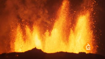 lava erupts from a volcano in a natural disaster