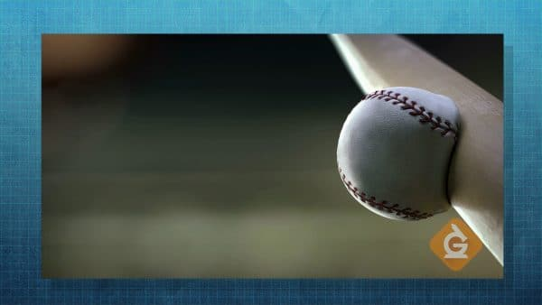 baseball collides with a bat in slow motion transferring energy
