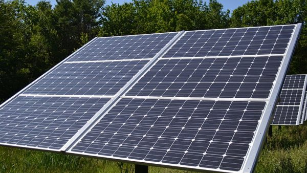 large solar panel in the forest collects sunlight as renewable energy