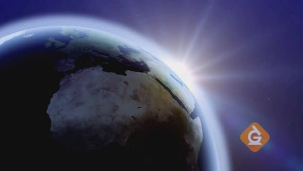sun rising from behind the earth