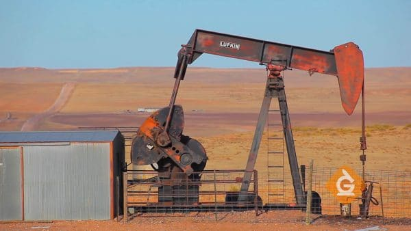 oil rig in desert pumps out oil