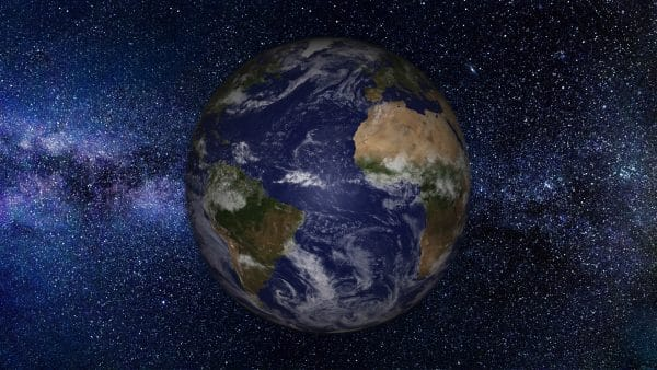 earth viewed from space with many stars visible to illustrate astronomy