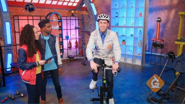Dr. Jeff pedals an exercise bike to teach us about human body systems