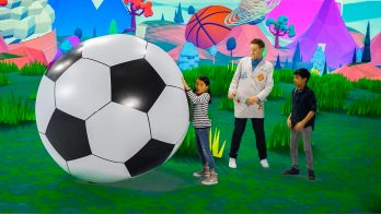 scientist and kids show how a ball can be pushed with force