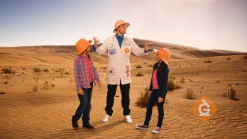 scientist explains sunlight to kids in the desert