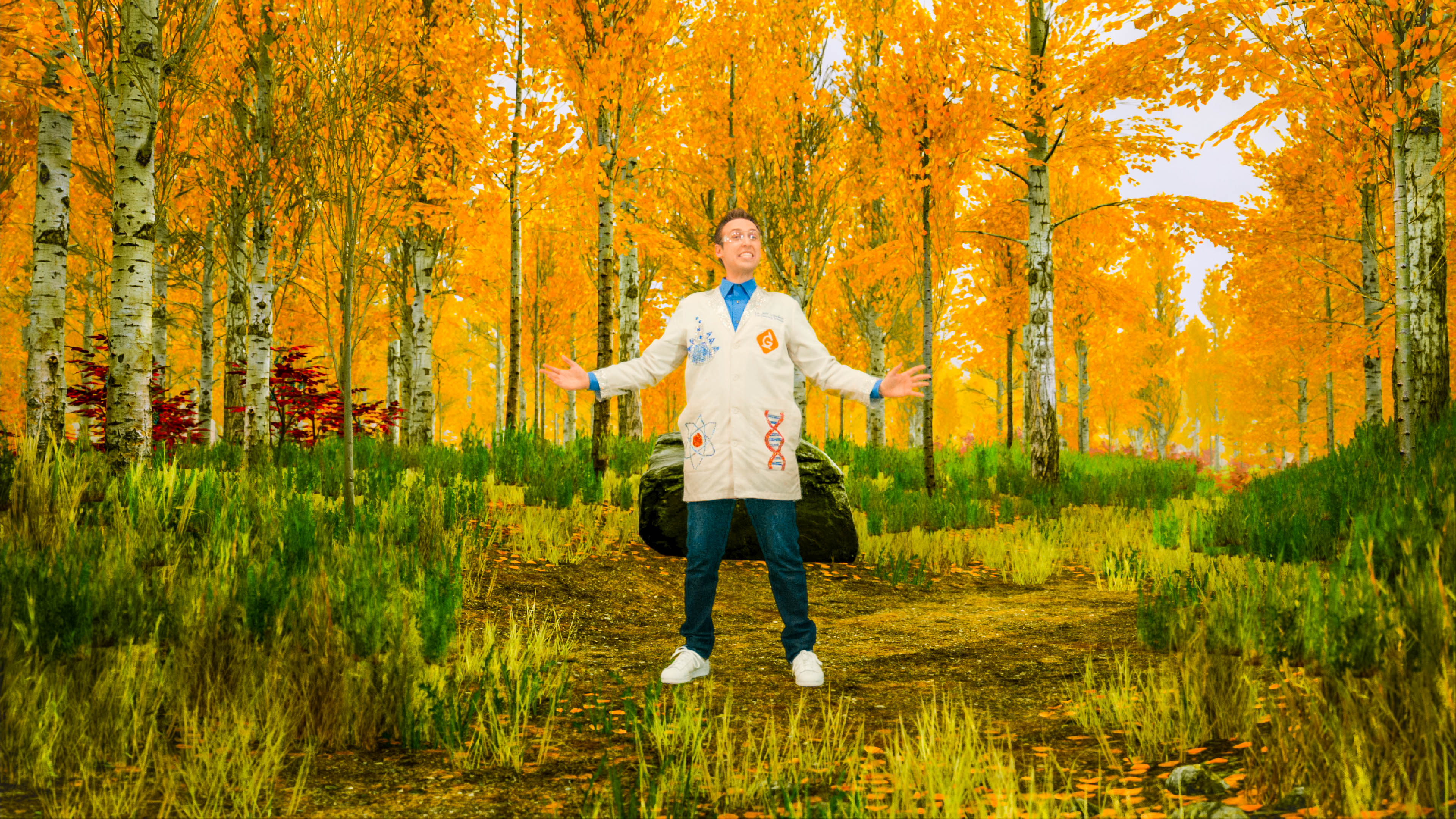 scientist stands in the forest with leaves turning colors due to the fall season