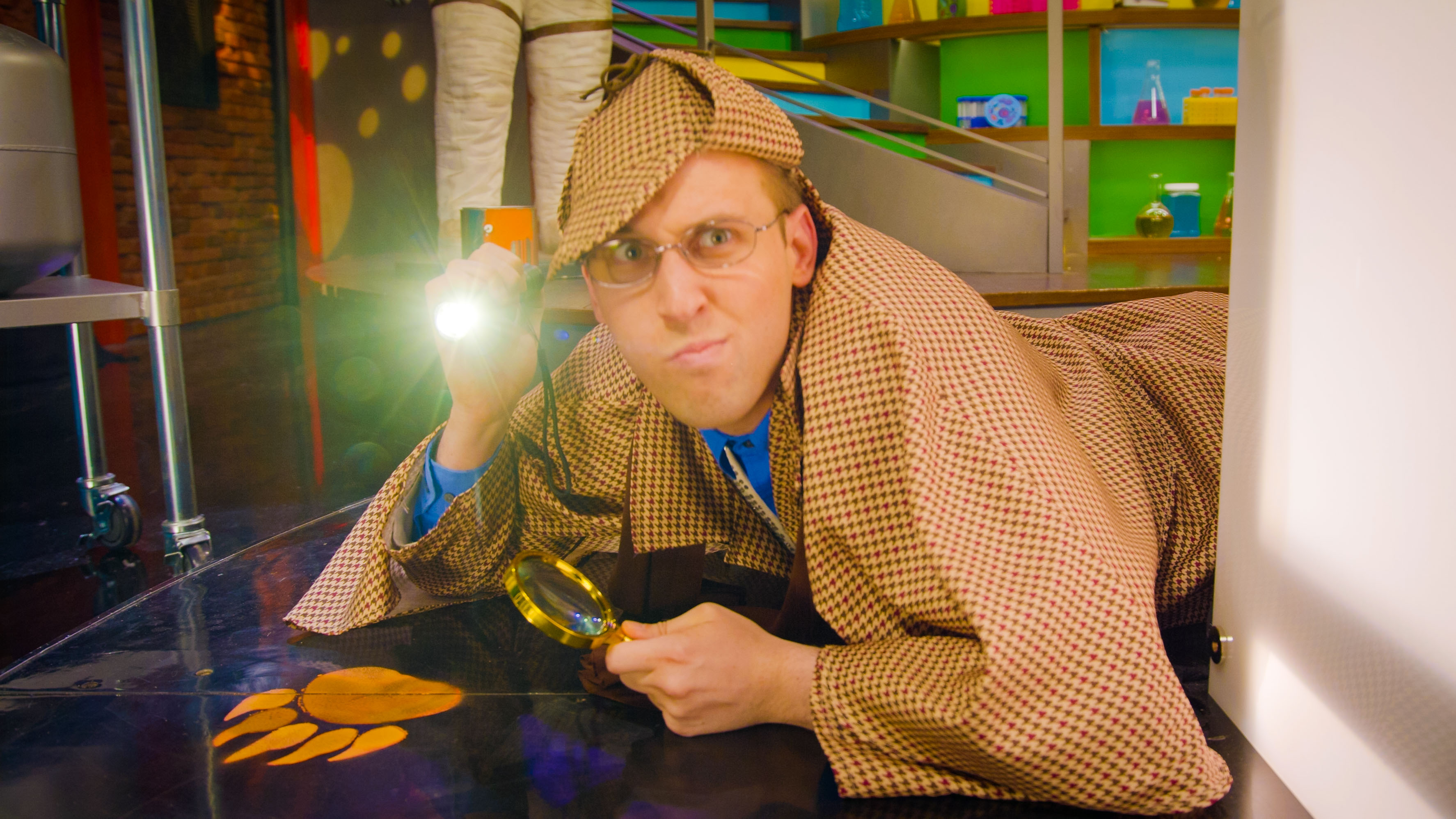 man looking for scientific evidence with flashlight