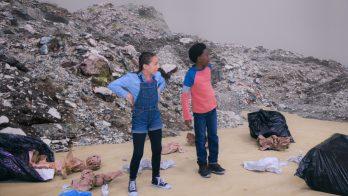 kids explore a garbage dump on a school trip