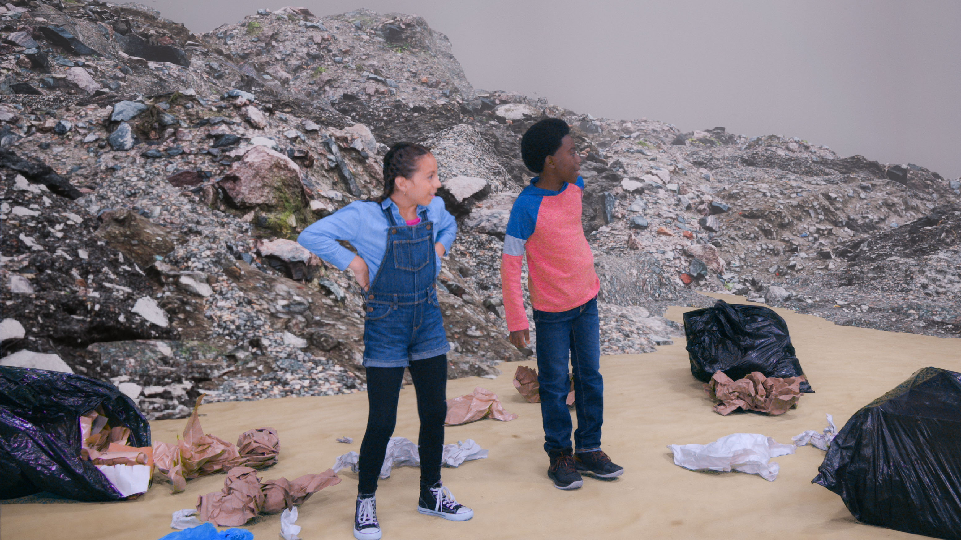 kids explore a garbage dump on a school trip