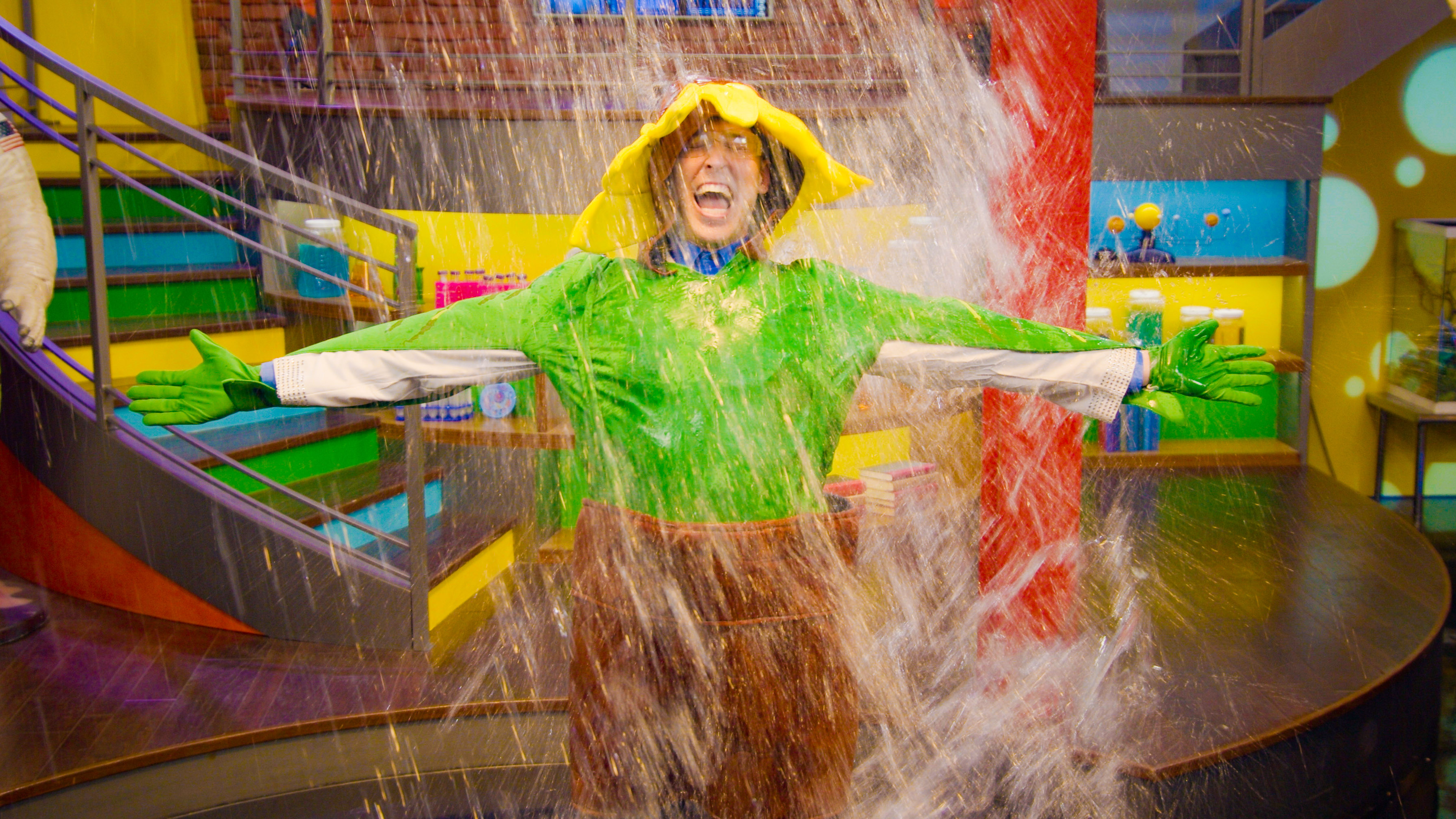 man in a plant suit gets drenched in water