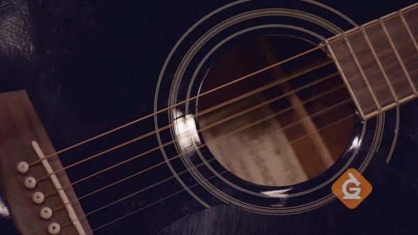 guitar string vibrates close up making sound