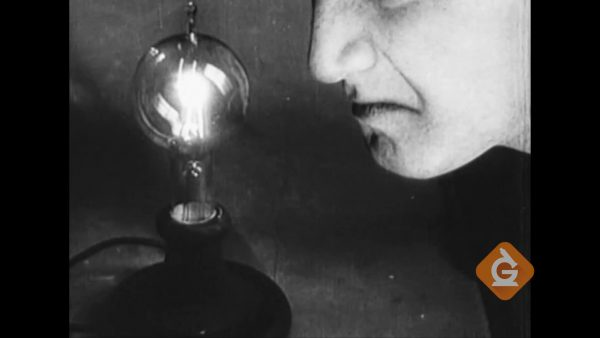 thomas edision observes the light bulb he invented