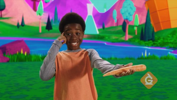 boy explains that a carrot is a solid because it keeps its shape