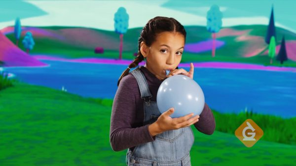girl blows up a balloon to discuss gases